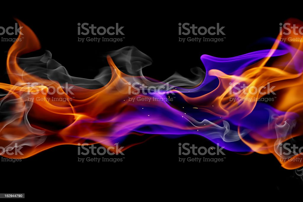 Blue and red fire against black background stock photo