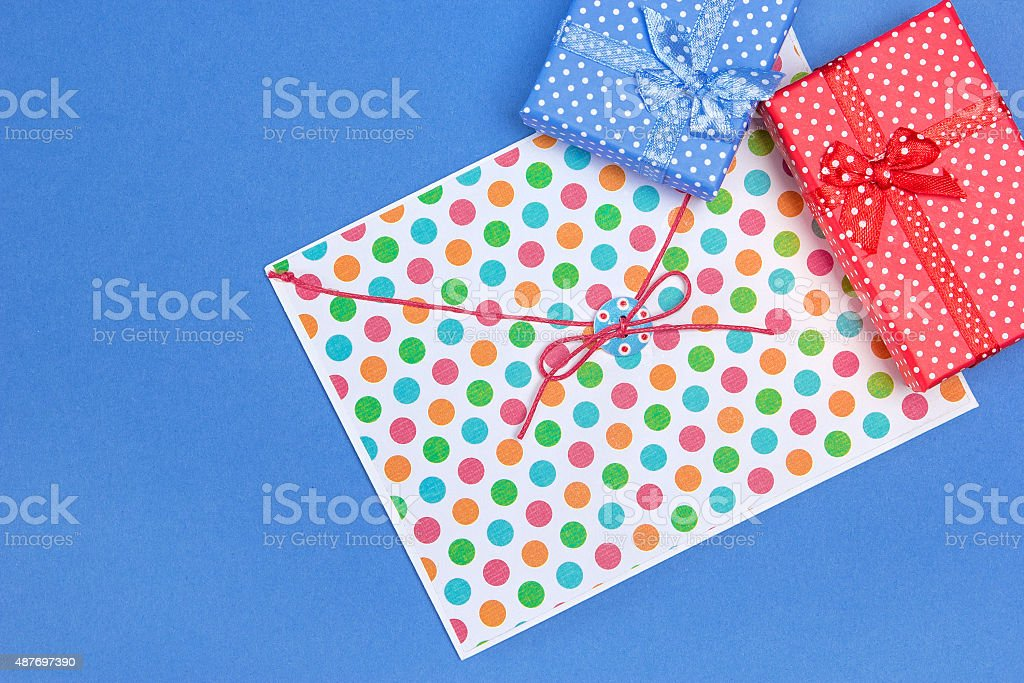 Blue and red gift boxes with envelope stock photo