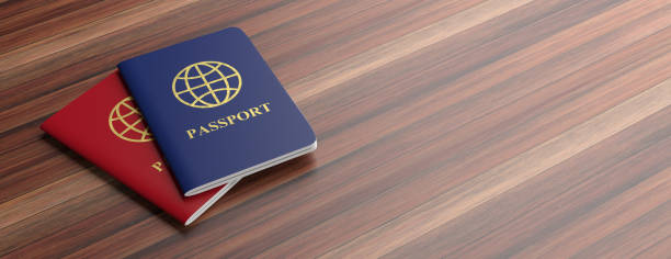 blue and red passports isolated on wooden background, banner, copy space. 3d illustration - grecia stato foto e immagini stock