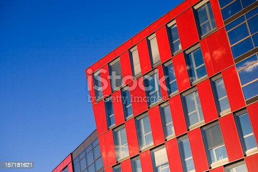 A contrast of colours and angles with this contemporary building offset against a deepening blue cloudless sky.