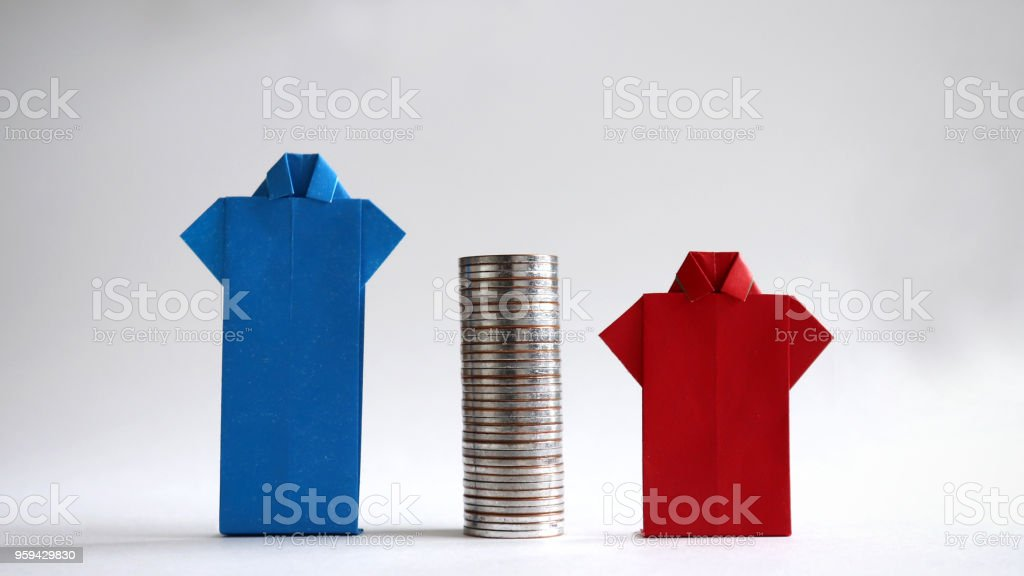 Blue and red shirts made of paper with piles of coins in between. The concept of gender employment and wage gap in the enterprise. stock photo