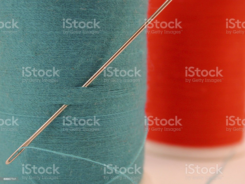 blue and red spool of thread royalty-free stock photo