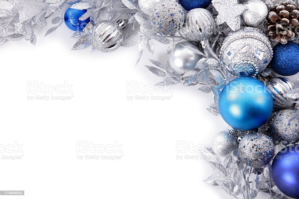 blue and silver christmas decorations against white backdrop royalty free stock photo