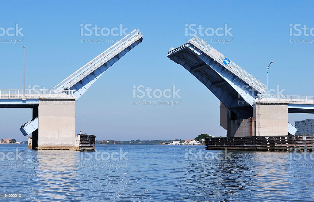 Blue and Steel Drawbridge Opening From On Water Perspective stock photo