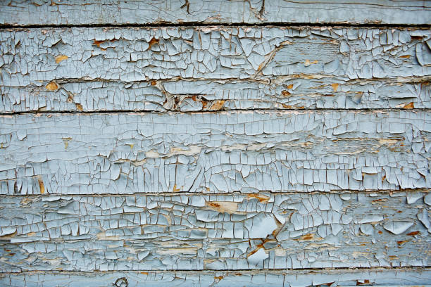 blue and turquoise old Board with cracks from old paint, vintage grunge style with cracked surface background for your text, decoration or advertising template, retro art stock photo
