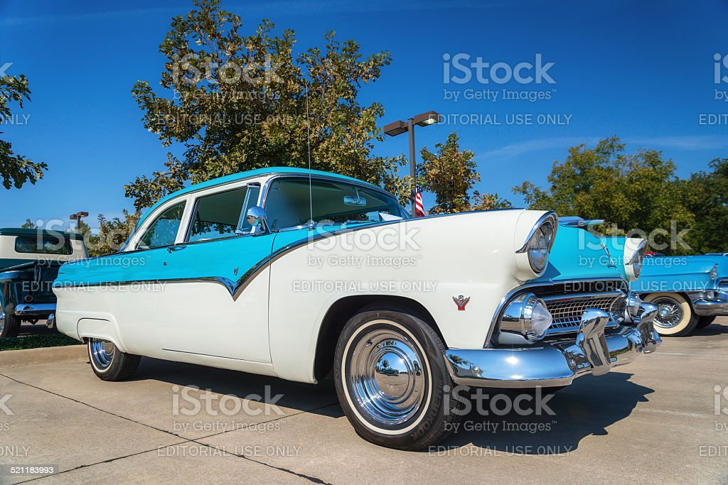 Blue and white 1955 Ford Fairlane classic car stock photo