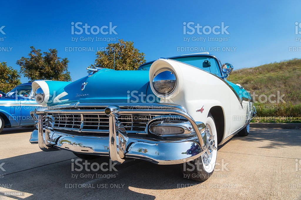 Blue and white 1956 Ford Fairlane Convertible classic car stock photo
