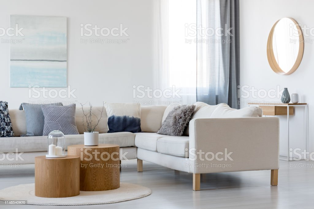 Blue And White Abstract Painting And Mirror In Wooden Frame In Elegant Living Room Interior With Corner Sofa And Coffee Table Stock Photo Download Image Now Istock