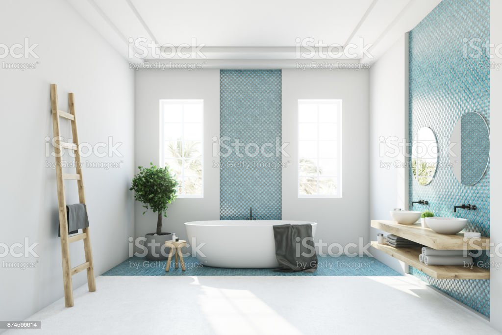 Blue and white bathroom, white tub stock photo