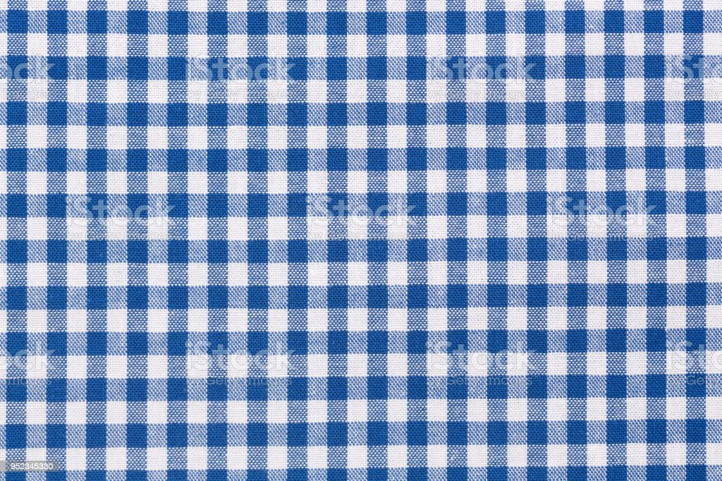 Blue and white checkered tablecloth stock photo