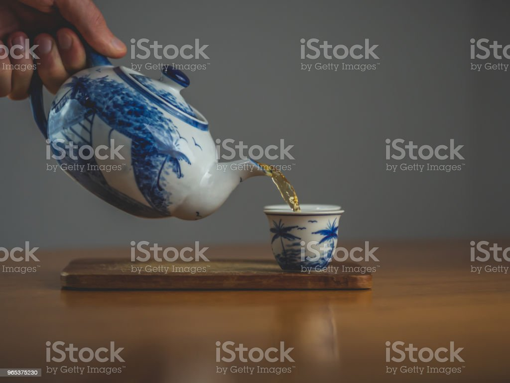 Blue and white china teapot with two matching cups royalty-free stock photo