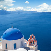 Blue and white church with bell tower in Santorini. Oia town, Greece landmark
