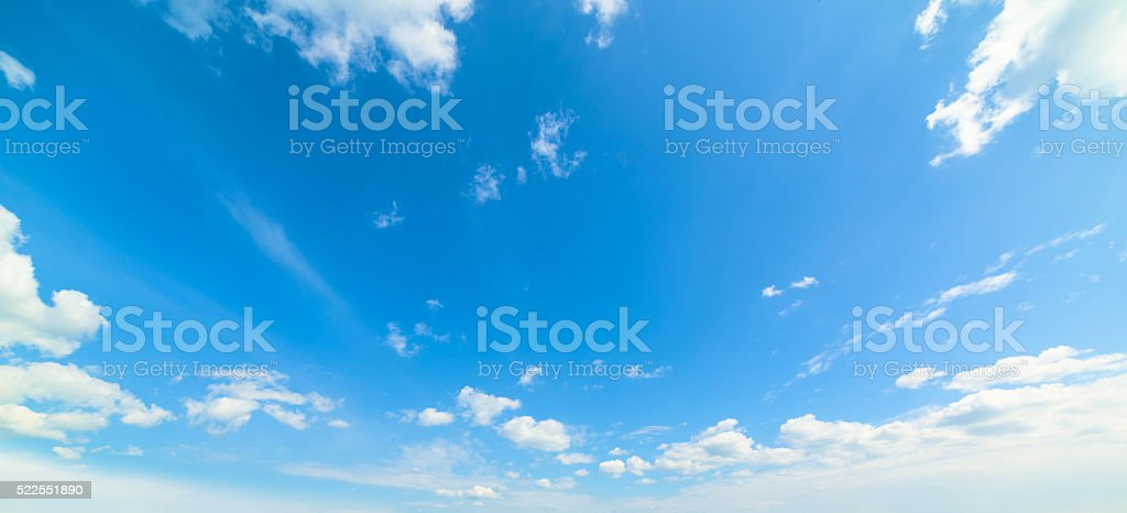 blue and white cloudscape stock photo