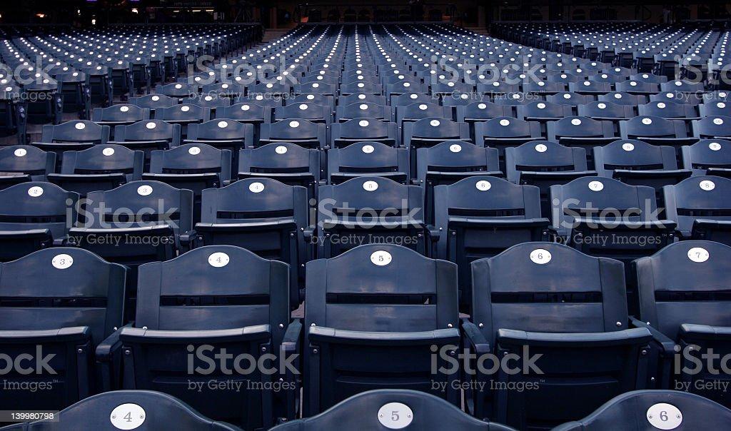 Blue and white empty stadium seats royalty-free stock photo