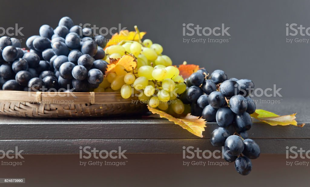 Blue and white grapes stock photo