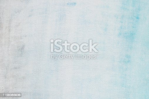 blue and white painted on artistic canvas background texture closeup