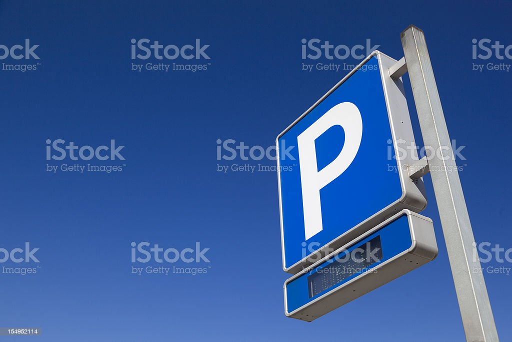 Blue and White Parking sign over blue sky stock photo