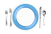 Place setting with blue accented plate.