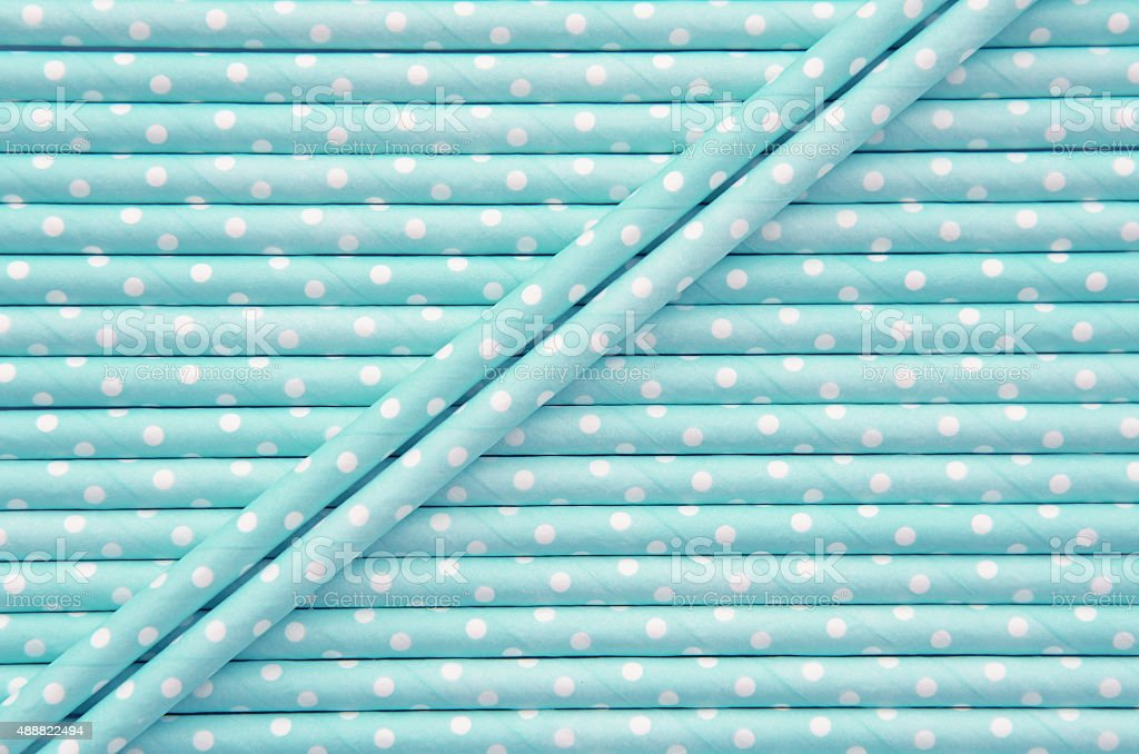 Blue and white polka dot paper straw background stock photo