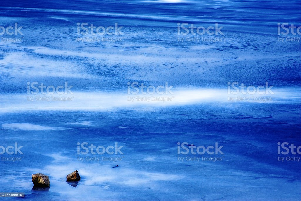 Blue and white sea stock photo