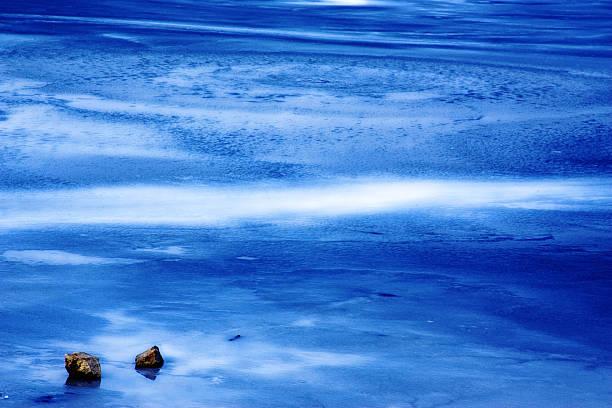 Blue and white sea stock photo