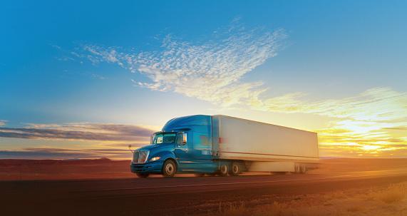 Blue and white semi-truck speeding on a single lane road USA
