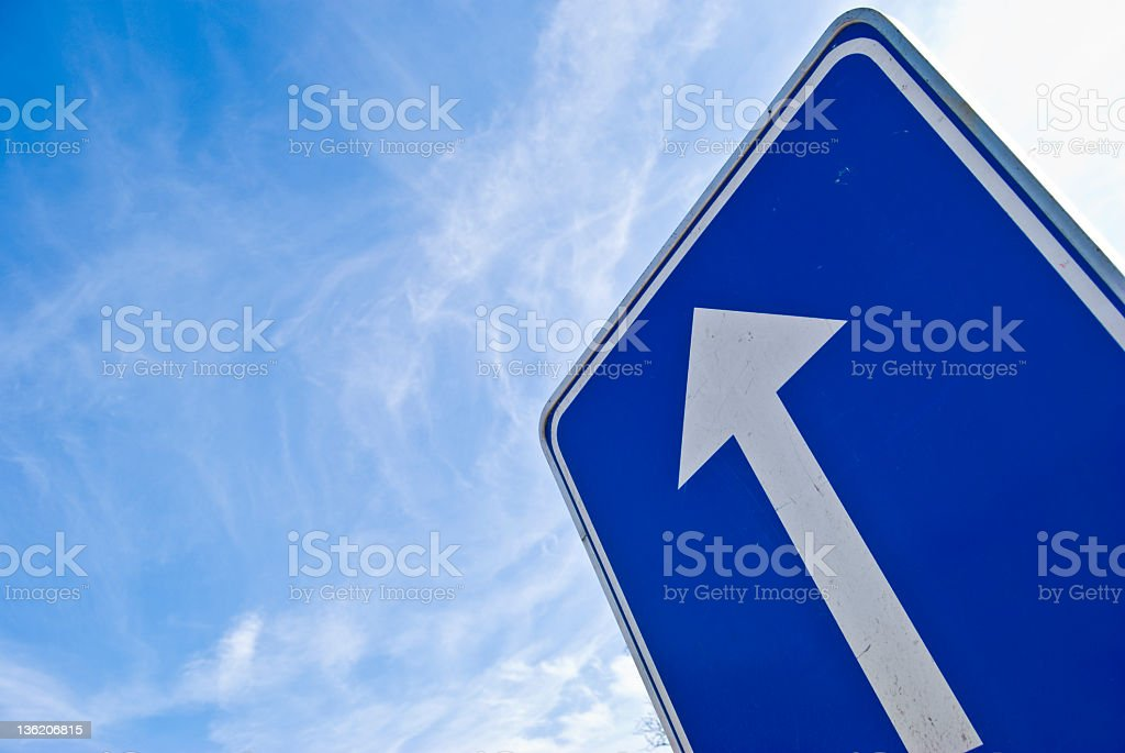 Blue and white sign indicating straight ahead royalty-free stock photo