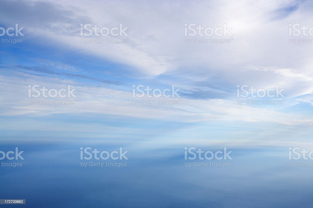 A blue and white sky with cirrostratus clouds stock photo