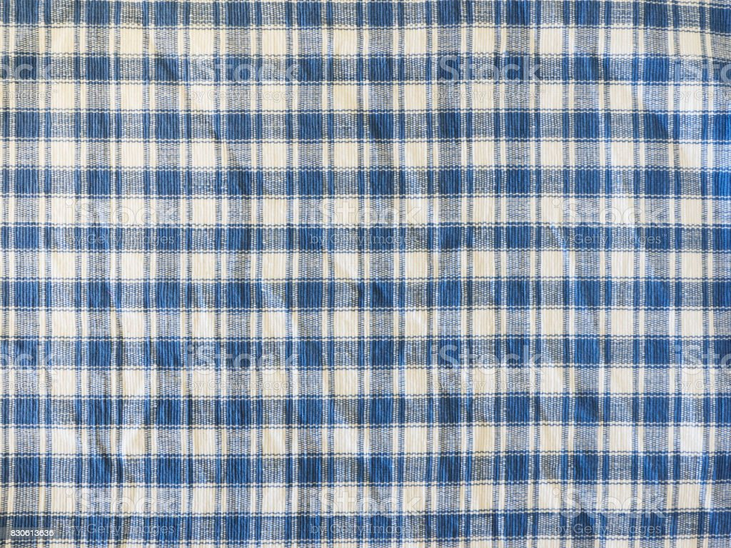 Blue and white squares fabric background stock photo