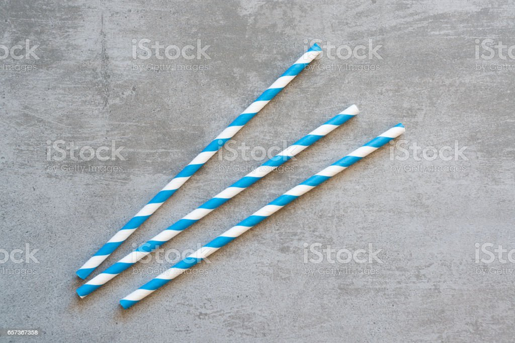 Blue and white striped drinking straws stock photo