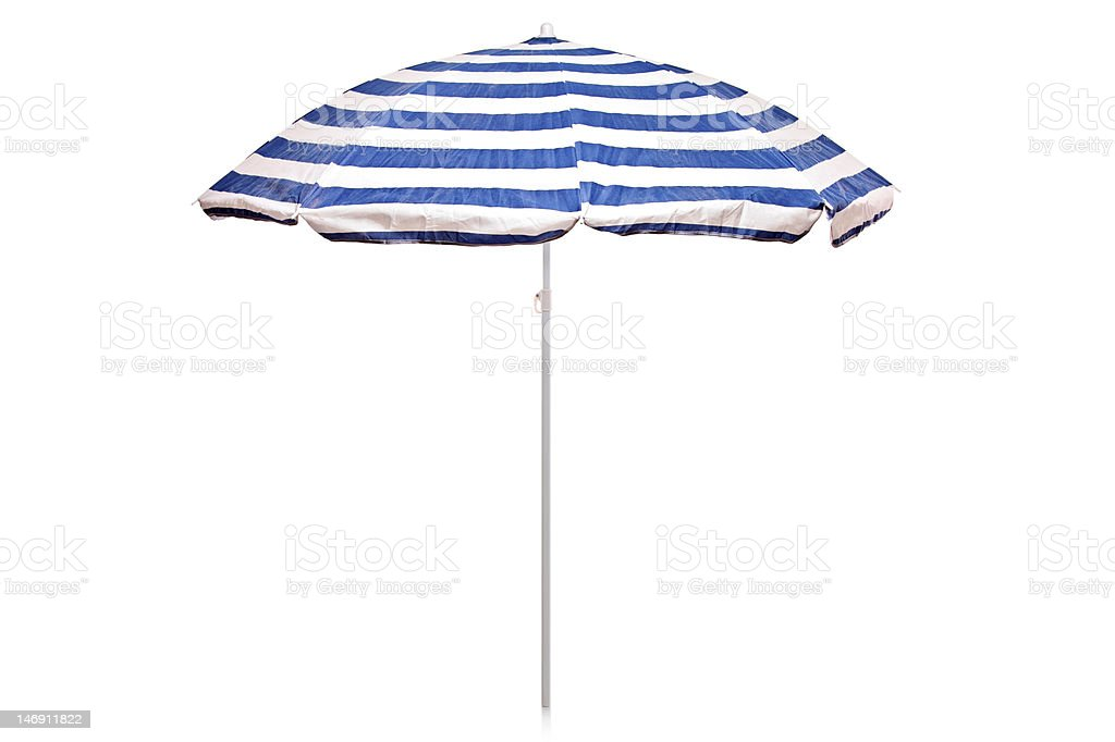 Blue and white striped umbrella stock photo