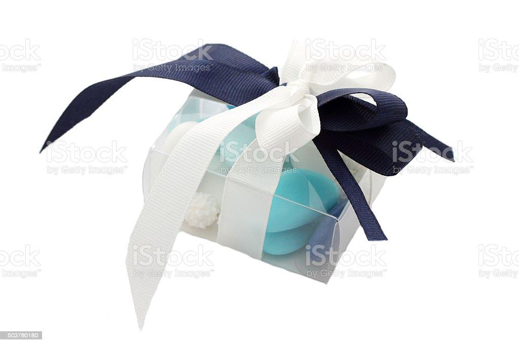 Blue and white sugared almonds in transparent plastic box stock photo