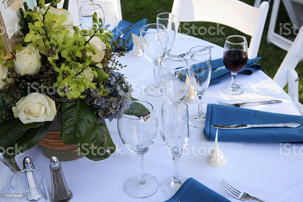 Blue and White table settings with flowers royalty-free stock photo