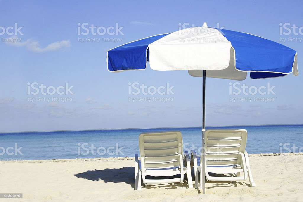 Blue and White Umbrella royalty-free stock photo