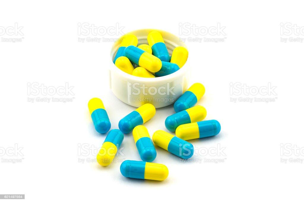 Blue and yellow antibiotic capsule photo libre de droits