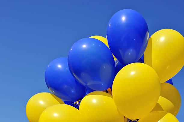 blue and yellow balloons in the city festival - blue yellow bildbanksfoton och bilder