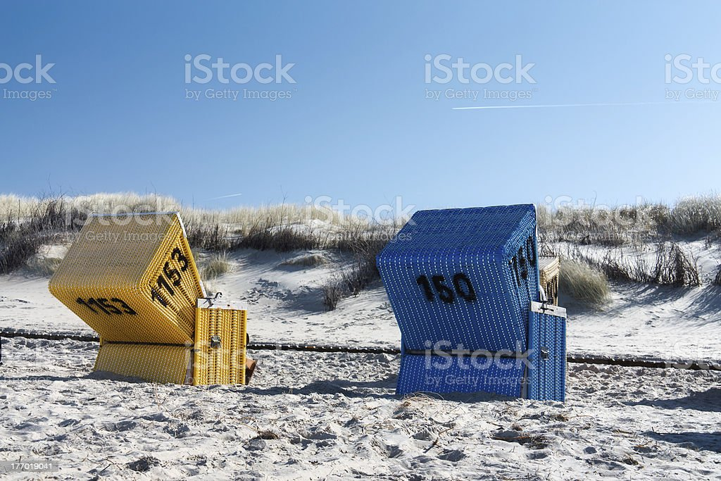 Blue and yellow beach chair stock photo