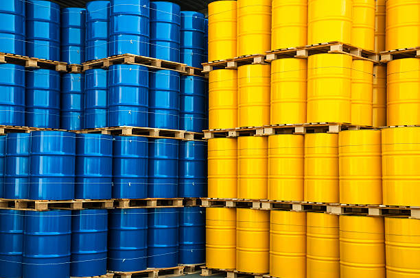 Blue and yellow oil drums stock photo