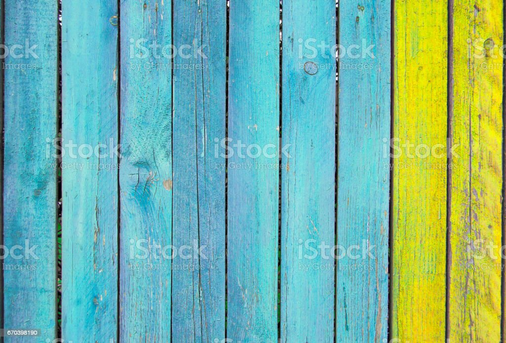 blue and yellow old wooden fence - foto de acervo