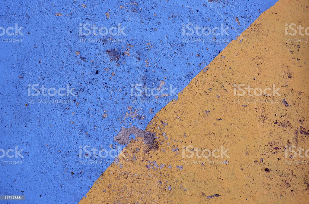 blue and yellow painted  concrete background royalty-free stock photo