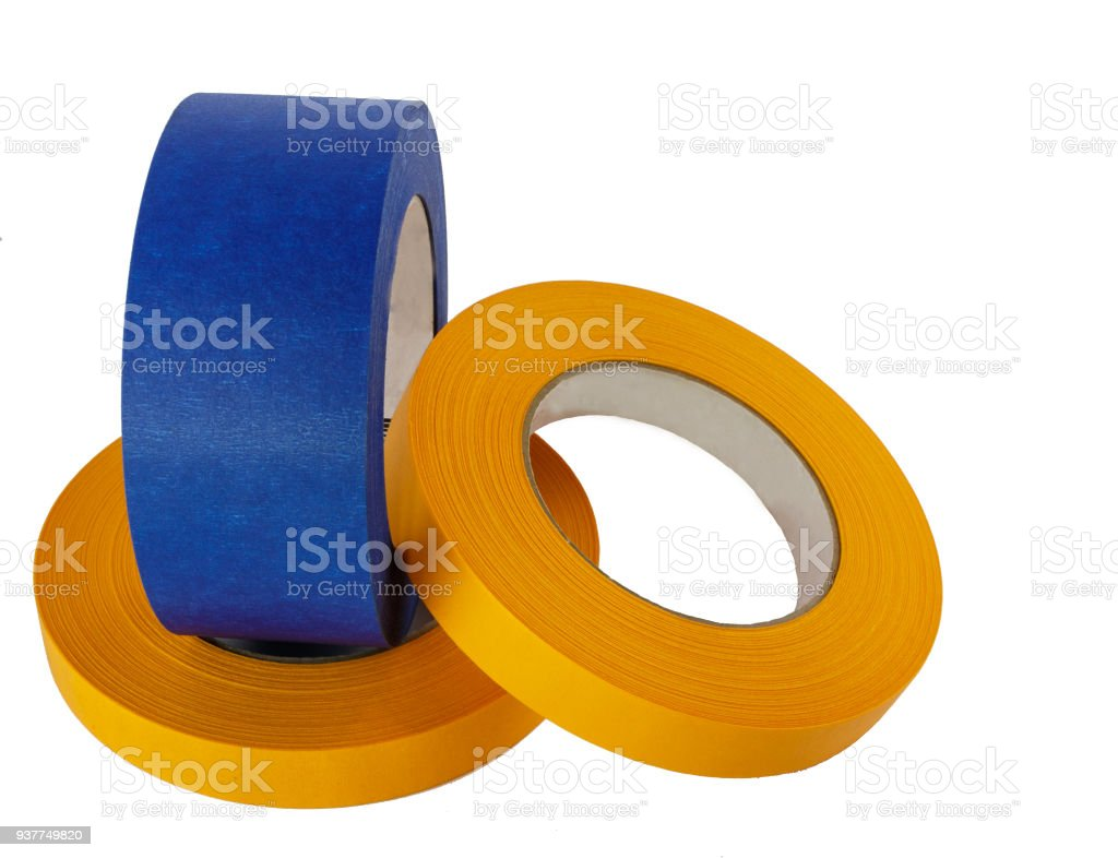 Blue and yellow painters tape rolls of assorted sizes stock photo