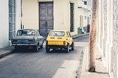 istock blue and yellow vintage car in Camagaey Cuba 1209873622
