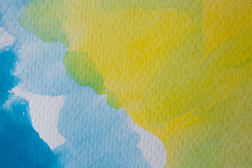 1084390994 istock photo Blue and yellow watercolor background. Abstract watercolor background on textured paper. Hand painted blue and yellow watercolor. 1011356410