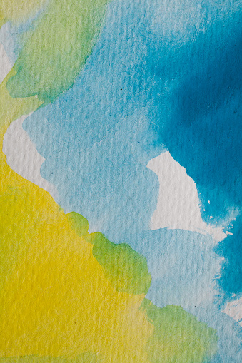 1084390994 istock photo Blue and yellow watercolor background. Abstract watercolor background on textured paper. Hand painted blue and yellow watercolor. 1011358726