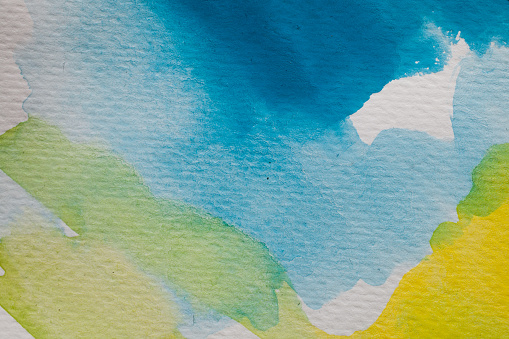 1084390994 istock photo Blue and yellow watercolor background. Abstract watercolor background on textured paper. Hand painted blue and yellow watercolor. 1011358738