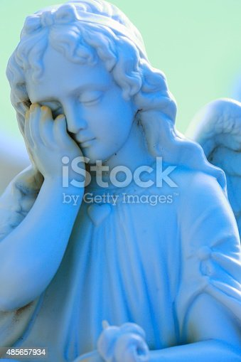 istock Blue angel: sad and shame - grave in public cemetery 485657934