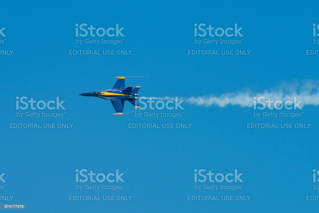 Blue Angels Navy Fighter Jet Performing Aerial Stunts stock photo