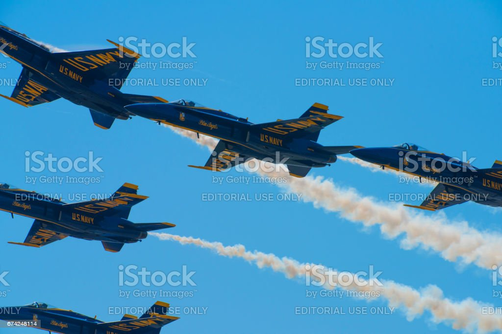 Blue Angels Navy Fighter Jets Performing Aerial Stunts stock photo
