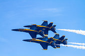 Miramar, USA - October 4, 2014: Miramar, California, USA- October 4, 2014 Blue Angels- The US Navy Flight Demonstration Squadron showing precision flying with their Boeing F/A-18 Hornet aircraft at the 2014 Miramar airshow in California. On this hot day the were many aircraft representing each military branch and displaying their aviation force.