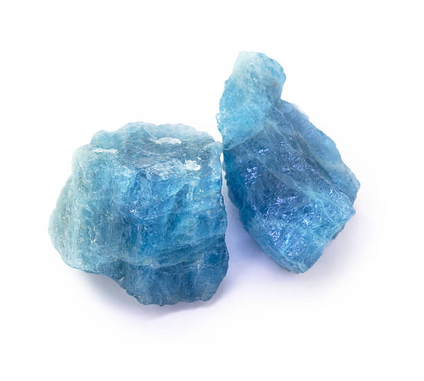 blue aquamarine raw gemstones on the white background. - smyckessten bildbanksfoton och bilder